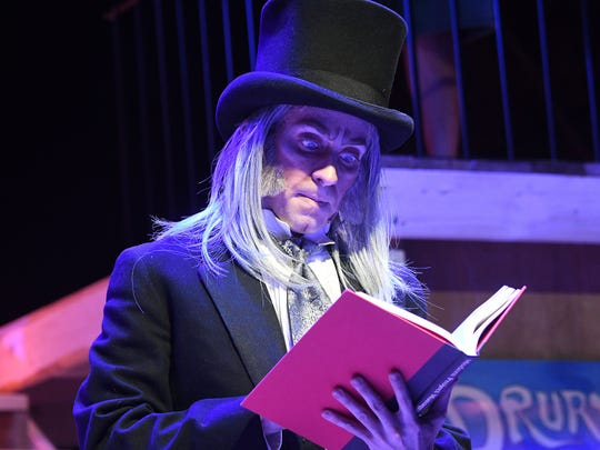 "Stephen Joshua Thompson stars as Scrooge in ""A Christmas Carol"" at the Renaissance Theatre."