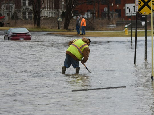A City of Mansfield employee clears debris from a storm