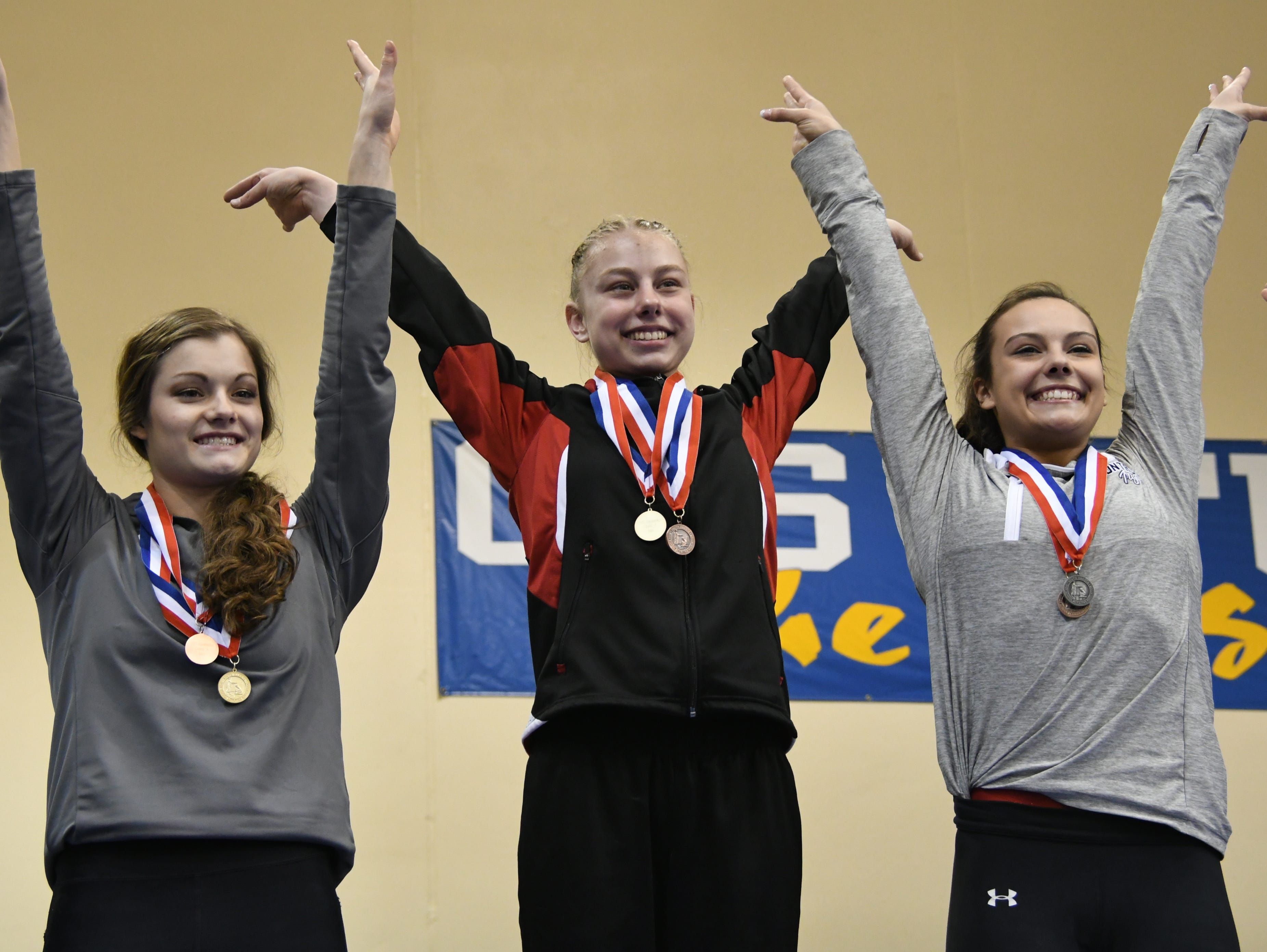 Top three finishers on bars in Class A. From left: Madison's Jenni Giles (3rd), Deuel's Morgan Kwasniewski (1st) and Montrose's Jocelyn Krouse (2nd)