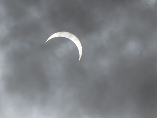 The moon passes in front of the sun during the eclipse