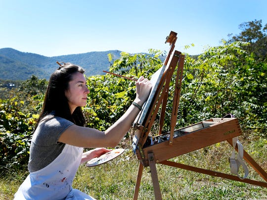 Bonnie Parker, of Asheville, works on a painting Oct. 19 along the Blue Ridge Parkway. October is the busiest time for cars, cyclists and hikers on the Blue Ridge Parkway.
