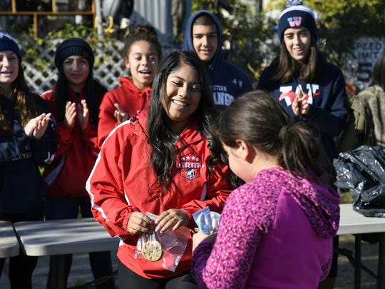 Tulare Western students sing Happy Birthday to a little girl at the annual Feed the Need event on Thursday.