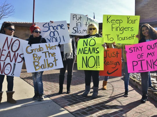 A group of women protested Assemblyman Devon Mathis' campaign kickoff at the Visalia Veterans Memorial Building Friday afternoon.