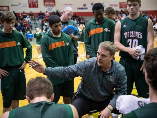 Vincennes Lincoln Head Coach Josh Thompson talks to his team during a timeout in the second quarter against the Bosse Bulldogs at Bosse High School in Evansville, Ind., Saturday, Jan. 27, 2018.