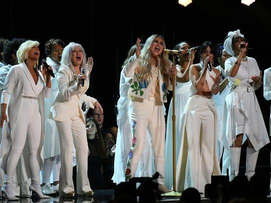 """Kesha, center, performs """"Praying"""" with Cyndi Lauper,"""
