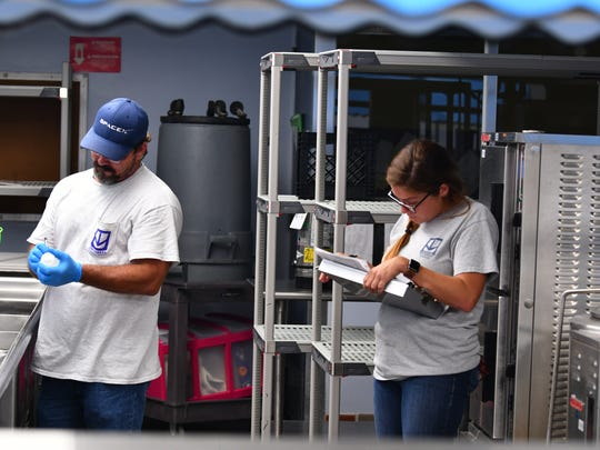 Brandon Selph and Megan Dearrigoitia, both project managers with Universal Engineering Services in Rockledge, were at schools in Satellite Beach Wednesday morning testing the water in sinks and water fountains for chemicals associated with fire extinguishing foams.