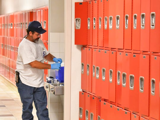 Brandon Selph, a project manager with Universal Engineering Services in Rockledge, were at Satellite High School in July testing tap water for fluorinated chemicals.