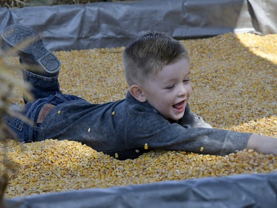 Walter Ray, 3, plays at Vossler Farms opening day on