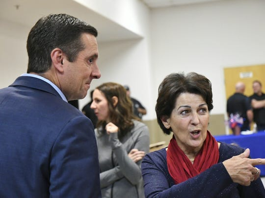 Devin Nunes (R-Tulare) speaks with voters during an Election Night party in Hanford.