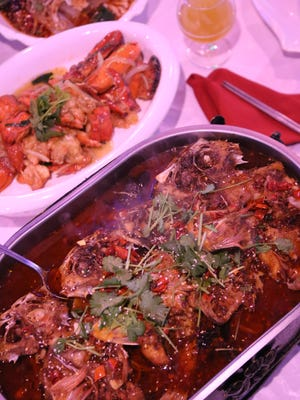 The Chongqing spicy grilled fish, served in a generous-sized banquet-style warming dish, is the most popular menu item at 168 KTV Bistro in Madison Heights.