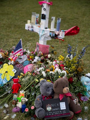 Memorials for the 17 students and faculty members that lost their lives in a school shooting last week at Pine Trails Park Tuesday, Feb. 20, 2018 in Parkland, Fla.