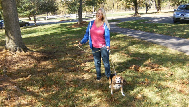 Barbara Oxenham, owner of There's No Place Like Home for Pets, walks Hayden, a client's dog. The business has marked 20 years in Somerset County.
