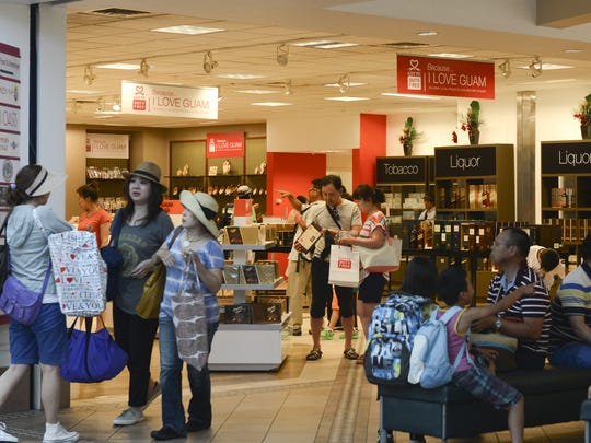 In this file photo, departing travelers look at products