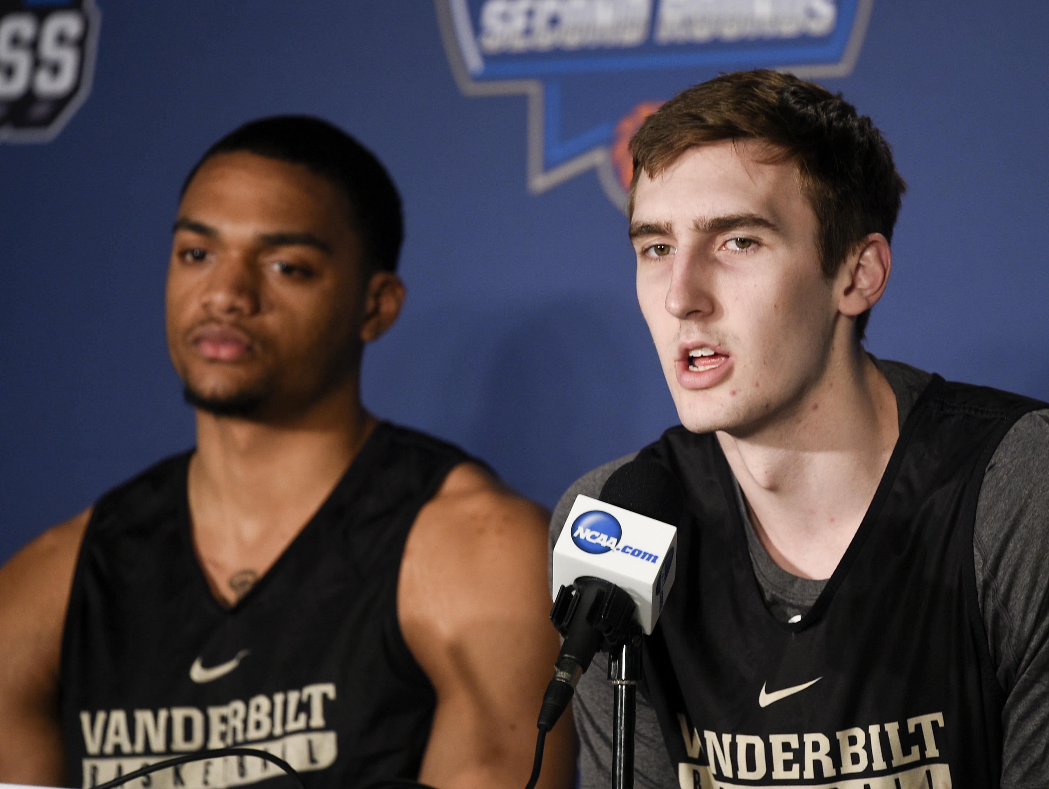 Vanderbilt forward Luke Kornet (right) talks during an interview Wednesday with the media at Vivint Smart Home Arena.