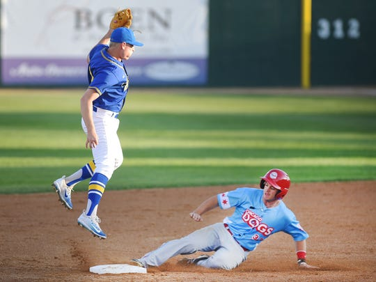 Canaries'  Tyler Wolfe attempts to get the out at second against the Chicago Dogs in the American Association opener Friday, May 18, at Sioux Falls Stadium.