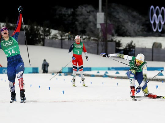 Jessica Diggins (USA) crosses the finish line for gold