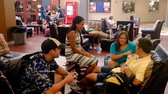 Louisiana College students spend time in the Student Center between classes on the first day of the fall semester on Monday.