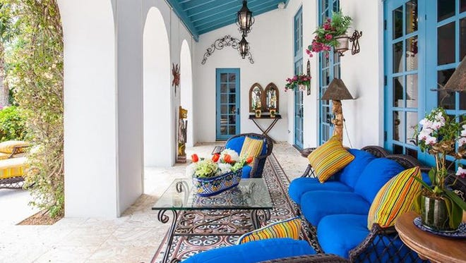 The home's loggia is spacious and colorful and looks out on the pool and gardens.