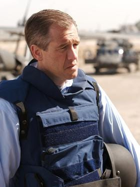 Brian Williams prepares to accept the Ring of Doom from Frodo.