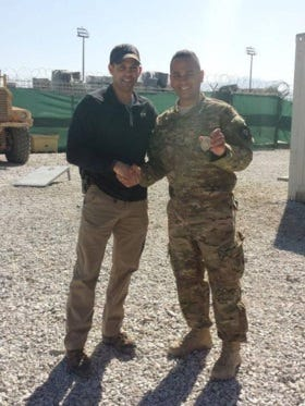 Lt. Col. Michael Mentavios, left, of the Air Force Office of Special Investigations recognizes Tech. Sgt. Flavio Martinez as an honorary Special Agent at Bagram Air Field in Afghanistan.
