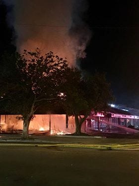 Crews knocked down a well-involved fire at a furniture store Sunday night that spread to adjacent units.
