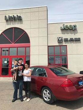 The Main family, clients of the homeless family advocate group Family Promise, were given a car by Lithia Dodge on Wednesday.