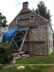 Work is in progress on the south side of the Stone Ridge Library's 1798 building.