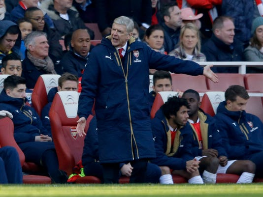 Arsenal's French manager Arsene Wenger gestures towards an official as he reacts in frustration during the second half of the English FA Cup quarterfinal soccer match between Arsenal and Watford at the Emirates stadium in London, Sunday, March 13, 2016.  (AP Photo/Matt Dunham)