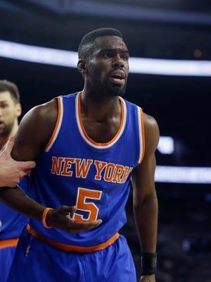 New York Knicks guard Tim Hardaway Jr. is helped off the court against the Detroit Pistons on Feb. 27, 2015, in Auburn Hills.