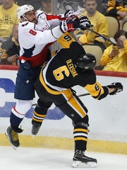 Washington Capitals' Alex Ovechkin (8) collides with
