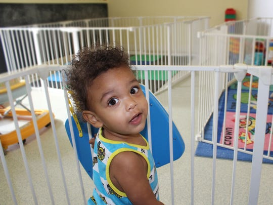 A child at Lifeline Family Center attends day care while mom is at work.