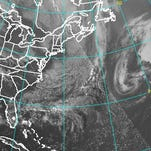 A satellite image taken Tuesday afternoon shows Subtropical Storm Melissa (right) spinning in the open Atlantic Ocean.