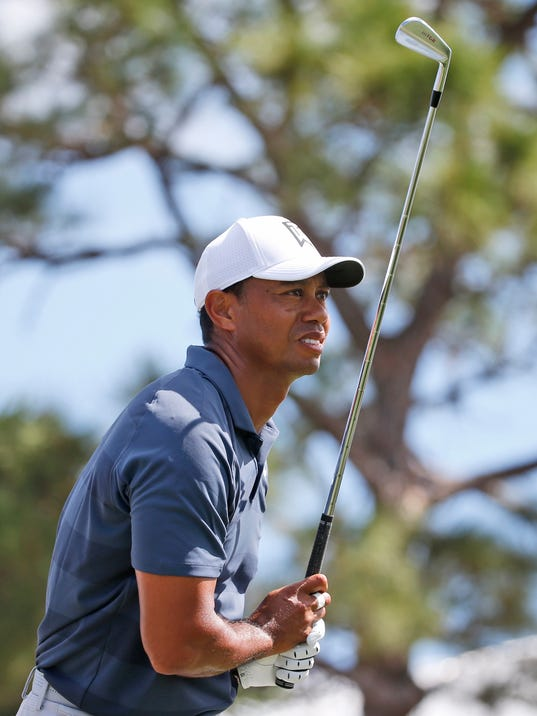 Tiger Woods watches his tee shot on the fourth hole during the third round of the Honda Classic golf tournament, Saturday, Feb. 24, 2018 in Palm Beach Gardens, Fla. (AP Photo/Wilfredo Lee)