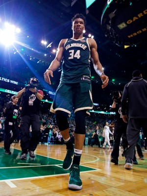 Milwaukee Bucks forward Giannis Antetokounmpo (34) walks off the court after the team's loss to the Boston Celtics in Game 7 of an NBA basketball first-round playoff series in Boston, Saturday, April 28, 2018. The Celtics won 112-96, eliminating the Bucks from the playoffs. (AP Photo/Charles Krupa) ORG XMIT: MACK120