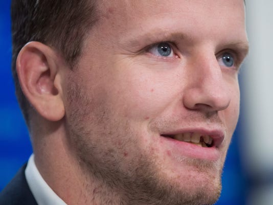 Derek Dorsett, who had to retire from playing professional hockey with the Vancouver Canucks recently due to medical reasons, speaks during a news conference in Vancouver, British Columbia, Wednesday, Dec. 6, 2017. (Darryl Dyck/The Canadian Press via AP)