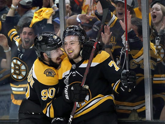 Boston Bruins' Charlie McAvoy, right, celebrates his goal against the St. Louis Blues with Marcus Johansson, left, during the second period in Game 1 of the Stanley Cup Final Monday. Boston won 4-2.