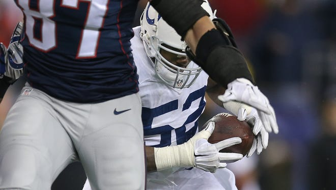Indianapolis Colts inside linebacker D'Qwell Jackson (52) intercepts a pass in the second quarter. The Indianapolis Colts play the New England Patriots in the AFC Championship game Sunday, January 18, 2015, at Gillette Stadium in Foxborough MA.