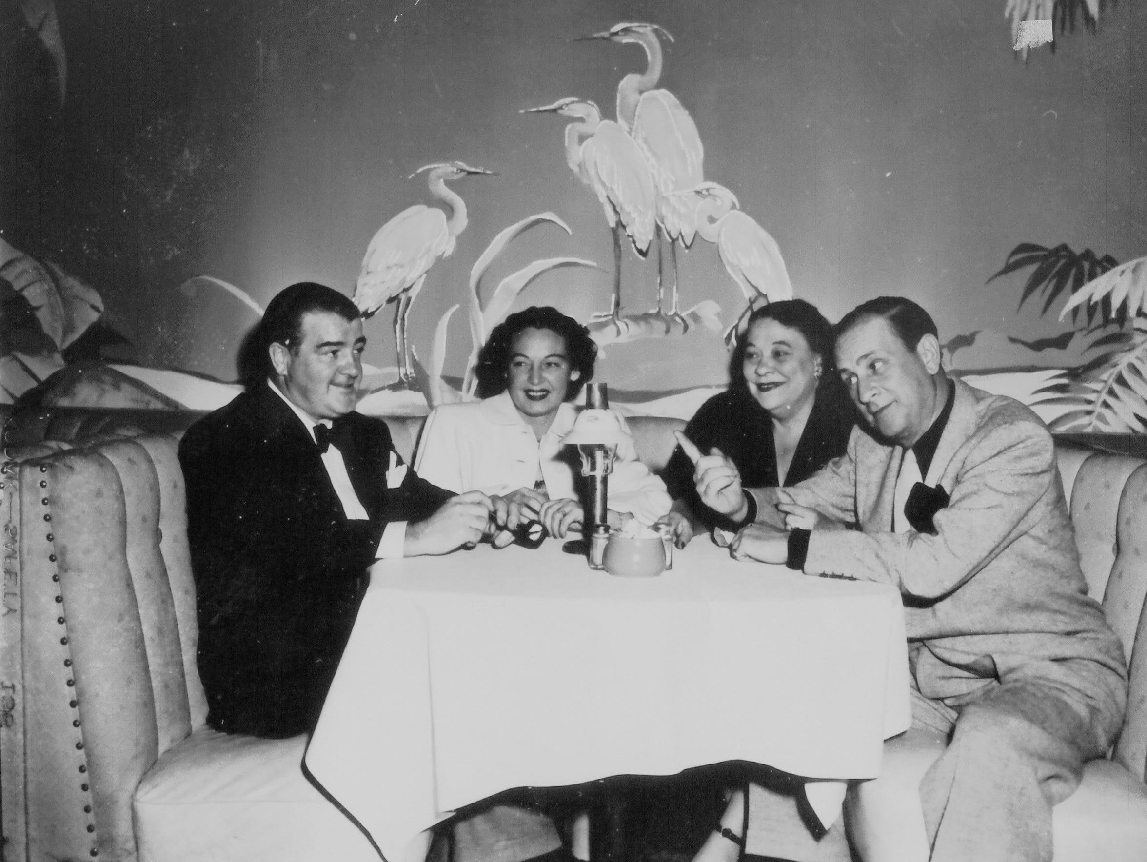 Lou Costello (far left) and Bud Abbott (far left) at