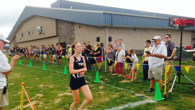Roberson's Lily Anderson won the Buncombe Country girls cross country championship for the second consecutive year Wednesday in Swannanoa.