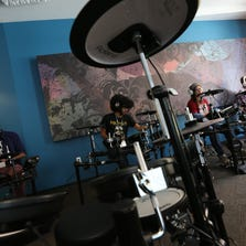 "Students practice on the electronic drums at the Detroit Institute of Music Education known as DIME officially opened its doors this summer in ""The new DIME building in Detroit. Tuesday, September 16, 2014. they hosted an open house as they are about to start the their first college level courses on September 22."