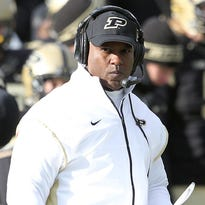 Purdue's head coach Darrell Hazell walks onto the field during a break in the second half of an NCAA college football game, Saturday, Nov. 22, 2014, in West Lafayette, Ind. Northwestern defeated Purdue 38-14. (AP Photo/Doug McSchooler)