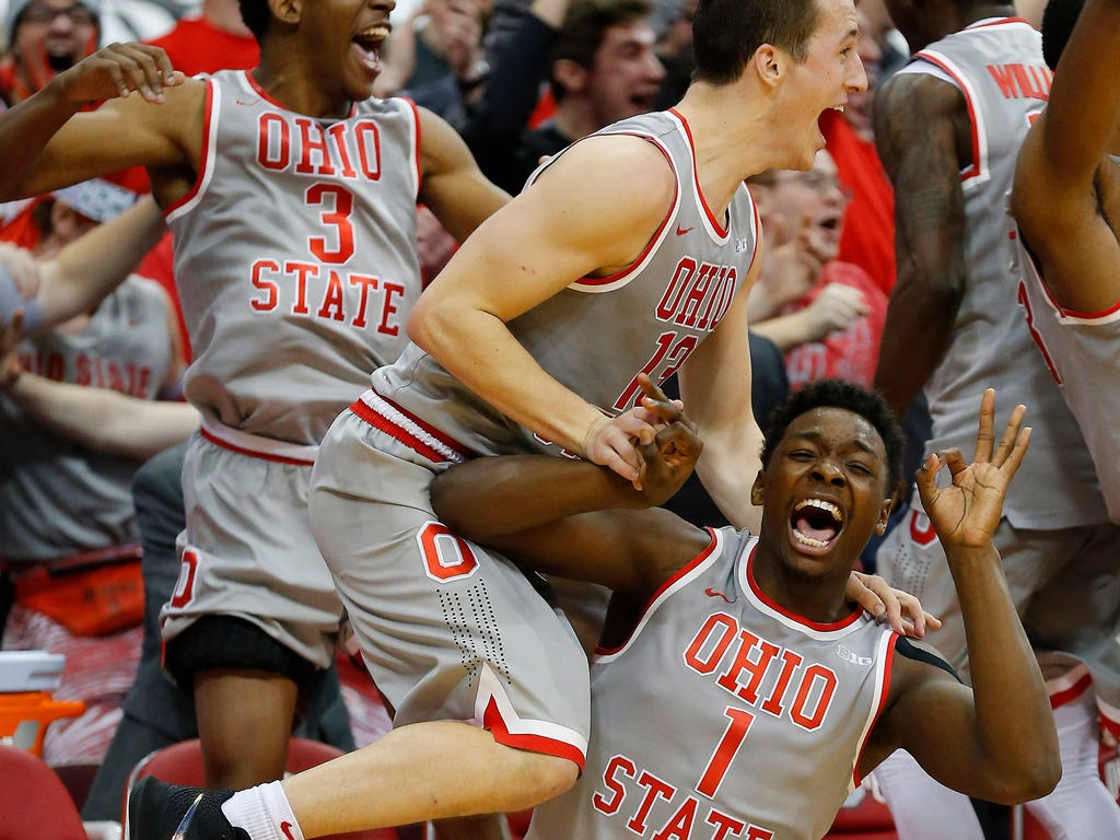 Ohio State Buckeyes forward Jae'Sean Tate (1) and guard Andrew Dakich (13) celebrate as the Buckeyes pull away from the Maryland Terrapins during the second half at Value City Arena.