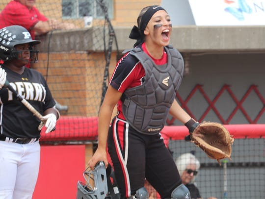 Lakota West catcher Hallie Gyarmati yells out orders