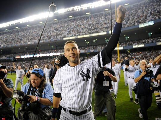 The Yankees' Derek Jeter waves to fans after New York beat the Orioles 7-3 on Sept. 21, 2008, at Yankee Stadium. The game was the last played there.