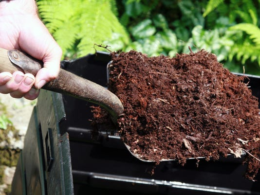 Hand Holding Shovel Full of Compost, Home Composting