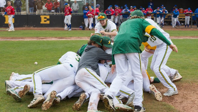 The Bishop Manogue team celebrates its win over Reno in the NIAA 4A Northern Regional Baseball Championship at Galena High School on  May 12, 2018.