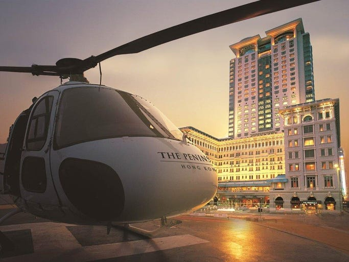 Travelers staying at the Peninsula Hong Kong can soar across the city via helicopter and land on the hotel helipad for the ultimate grand entrance.