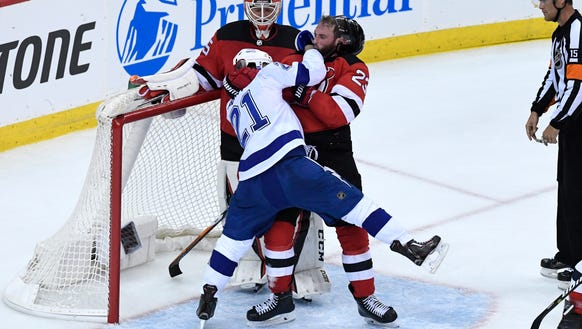 Tampa Bay Lightning center Brayden Point (21) and New
