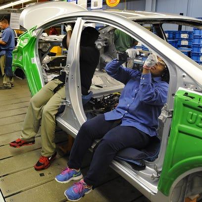Hyundai team members assemble vehicles at Hyundai Motor