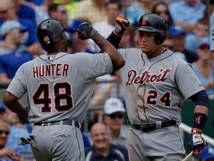 Tigers right fielder Torii Hunter, left, celebrates his home run with Miguel Cabrera during the fourth inning against the Kansas City Royals on Saturday, Sept. 20, 2014, in Kansas City, Mo.